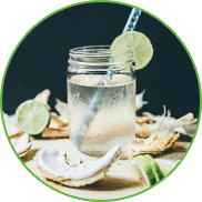 Coconut water in a glass with appetizing garnish.